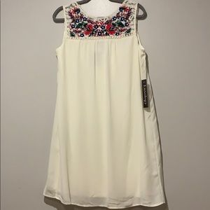 Dress off white with colored lace flowers on top